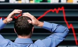 BCW2K1 Stock Trader Clutching His Head in Front of a Screen Showing a Stock Market Crash